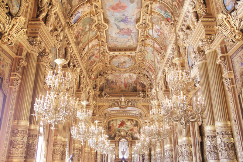 the grand foyer at the opera garnier, paris france. chandeliers