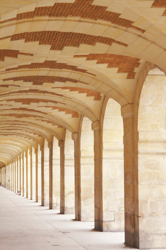 arched gallery at the place des vosges in the marais paris france