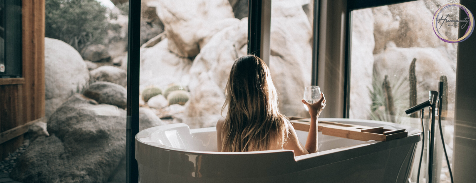Relax in the bath with a glass of wine