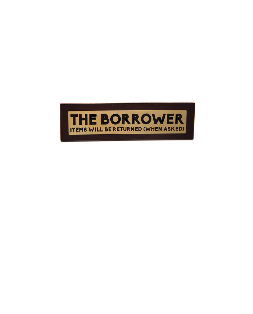 Desktop sign: The Borrower by Driftroom