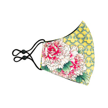 Load image into Gallery viewer, Side view of fabric reusable face mask with pink peonies on the right side on a lemony yellow background.