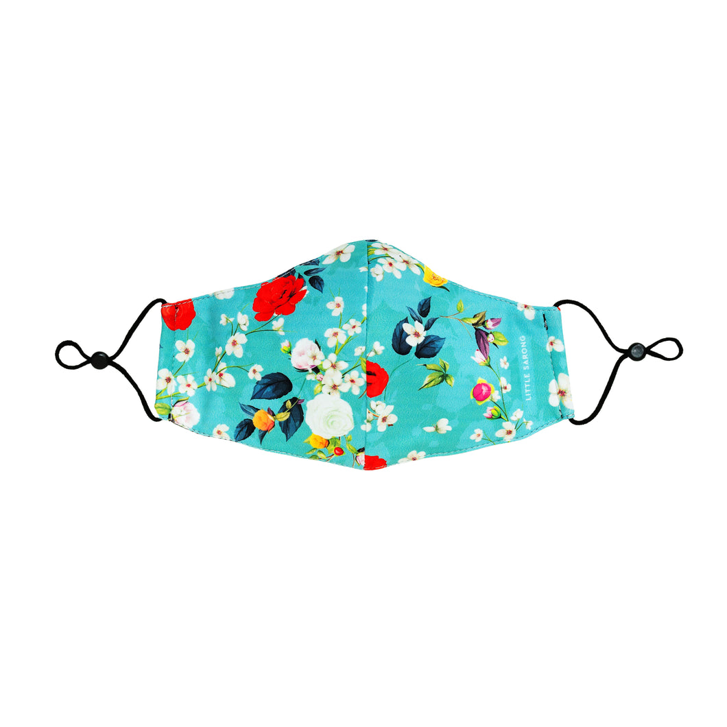 Full front view of fabric reusable face mask in blue Chinese floral design.