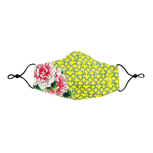 Full front view of fabric reusable face mask with pink peonies on the right side on a lemony yellow background.
