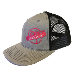 Light grey snapback with black mesh made in Hinton, Alberta with the Risky not Reckless logo supporting the Alberta Cancer Foundation and breast cancer awareness.