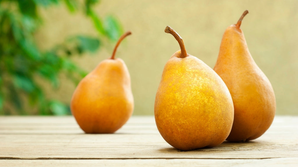 Three pears standing on a table