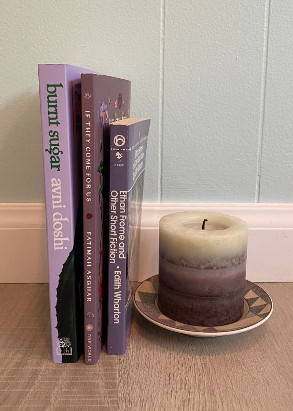 3 lavender books and a candle including if they come for us by fatimah asghar