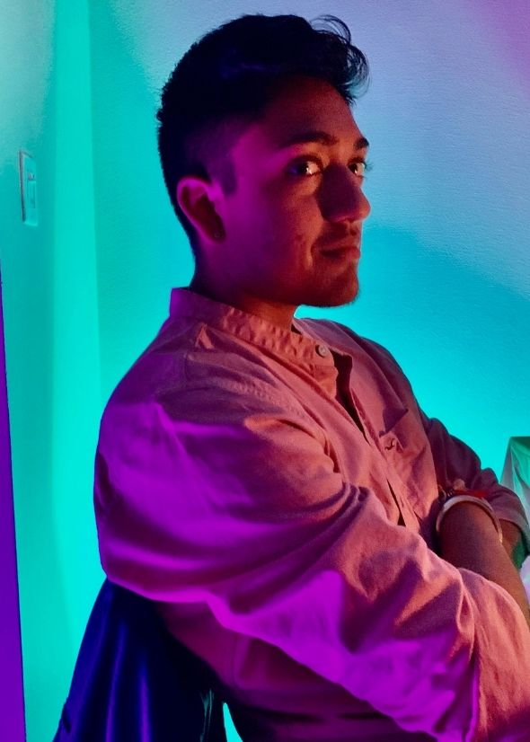 Zayn Singh in purple and teal lighting