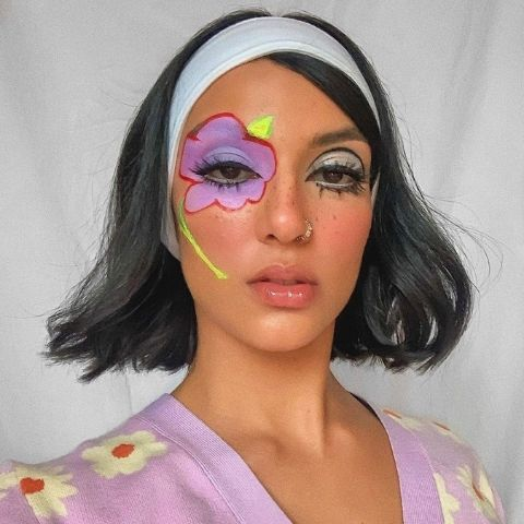Rowi Singh wearing lavender flower makeup