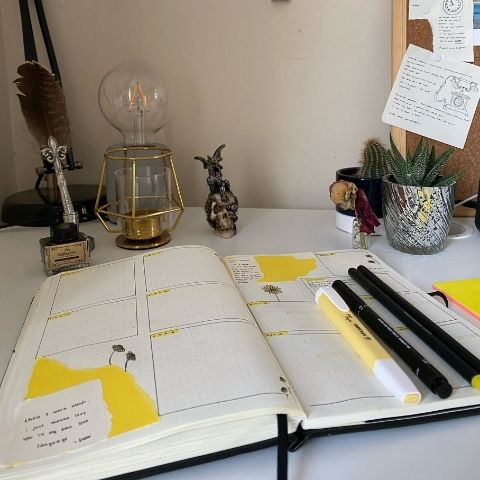 Naan's desk space with an open journal