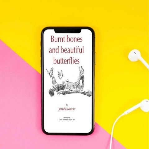 Burnt Bones and Beautiful Butterflies book against yellow and pink backdrop