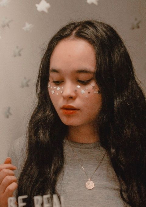 Isa Medina-Kim wearing silvers stars on her face