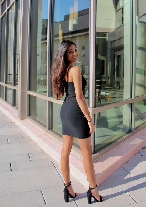 Rishika Jikaria wearing a black dress