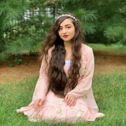 Reclamation founder Simra Mariam wearing a pink dress