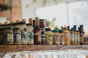 Jars and bottles of condiments on a shelf