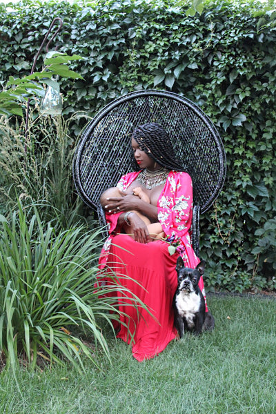 Fighting Societal Expectations of Breastfeeding One Baby At a Time