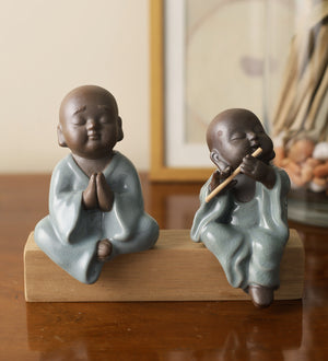 Pair of monk praying and playing flute