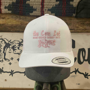 Cow Lot Logo Cap | Solid White with Pink Embroidered  Logo