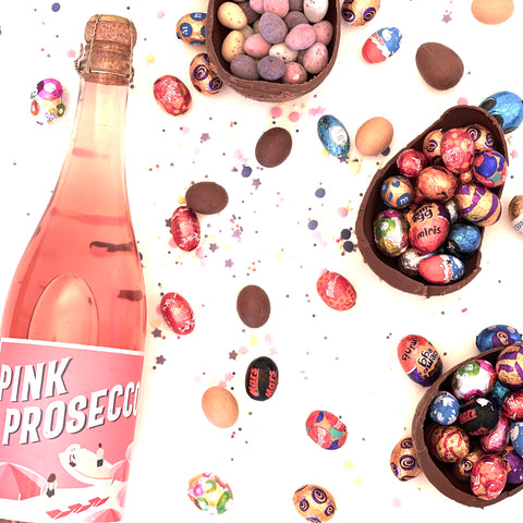 Pink Prosecco bottle with colourful chocolate Easter eggs
