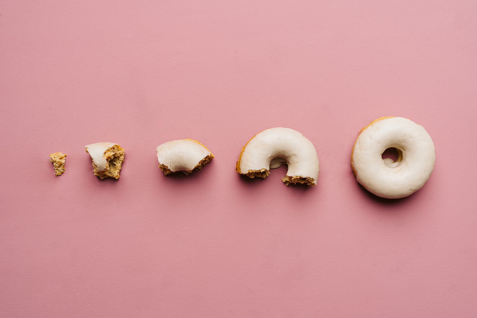 Evolution of Original Maple Glazed gluten free protein donut from Holly's Healthy Holes in Omaha, Nebraska with pink background photography by Pixel Bakery Design Studio in Lincoln, Nebraska from photographer Yoni Gill