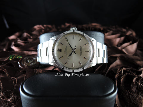1970 Rolex OYSTER PERPETUAL 1007 Silver Dial Engine Turned Bezel with Box and Paper