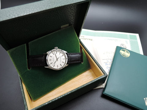 1971 Rolex OYSTER PERPETUAL 1007 Silver Dial Engine Turned Bezel with Box and Paper