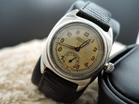 1940 Rolex Cushion Case with Yellowish Arabic Dial and Sub Seconds