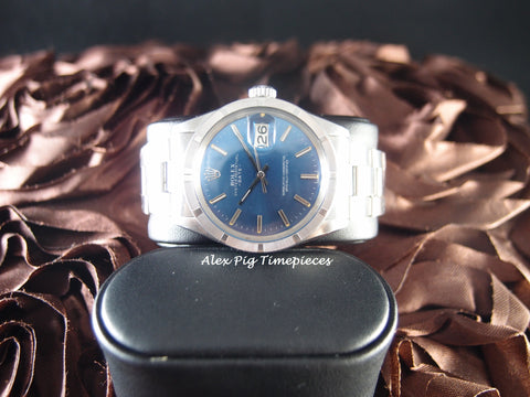 Rolex OYSTER DATE 1501 with Engine Turned Bezel and Original Blue Dial