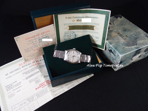Rolex OYSTER DATE 1500 Original Silver Dial with Blue Hand, Box and Paper
