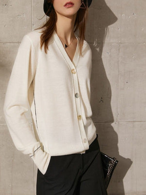 Buttoned spring wool blouse with a V-neck