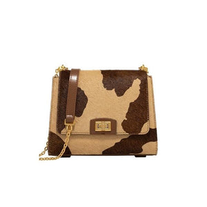 Rosaline as picture show 1 A shoulder bag with a cowhide design