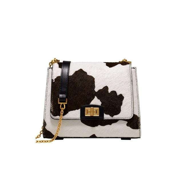 Rosaline as picture show A shoulder bag with a cowhide design