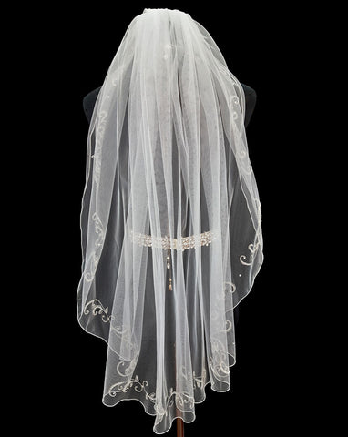 Bridal and wedding Veil  - ONE ONLY - one tier silver embroidered scroll in white with a machine edge - back view - at Kezani