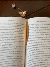 Gold metal feather bookmark with butterfly and flower pendant