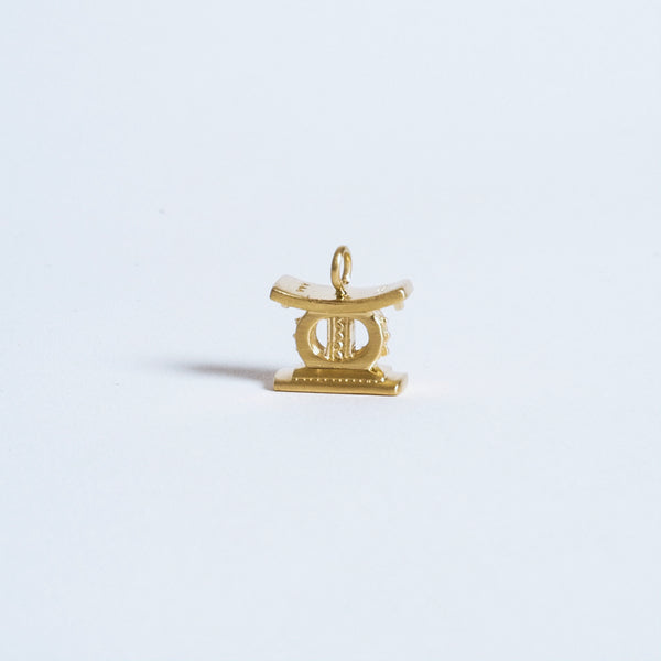 The Golden Stool Pendant