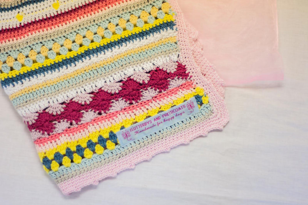 100% cotton baby blanket in pink, blue, yellow & peach hues, hand-crocheted with various stitches. An absolute treat for mummy and baby alike.