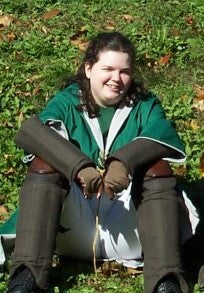 Jen in her Slytherin Quidditch gear, early 2000s