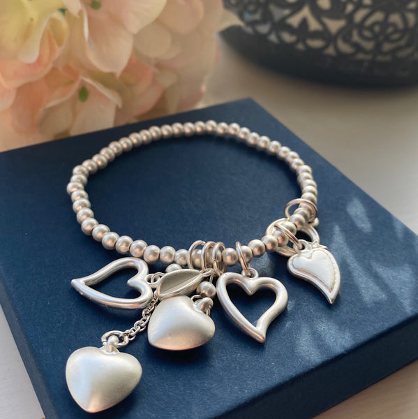 BRUSHED CHARMS SILVER PLATED BRACELET