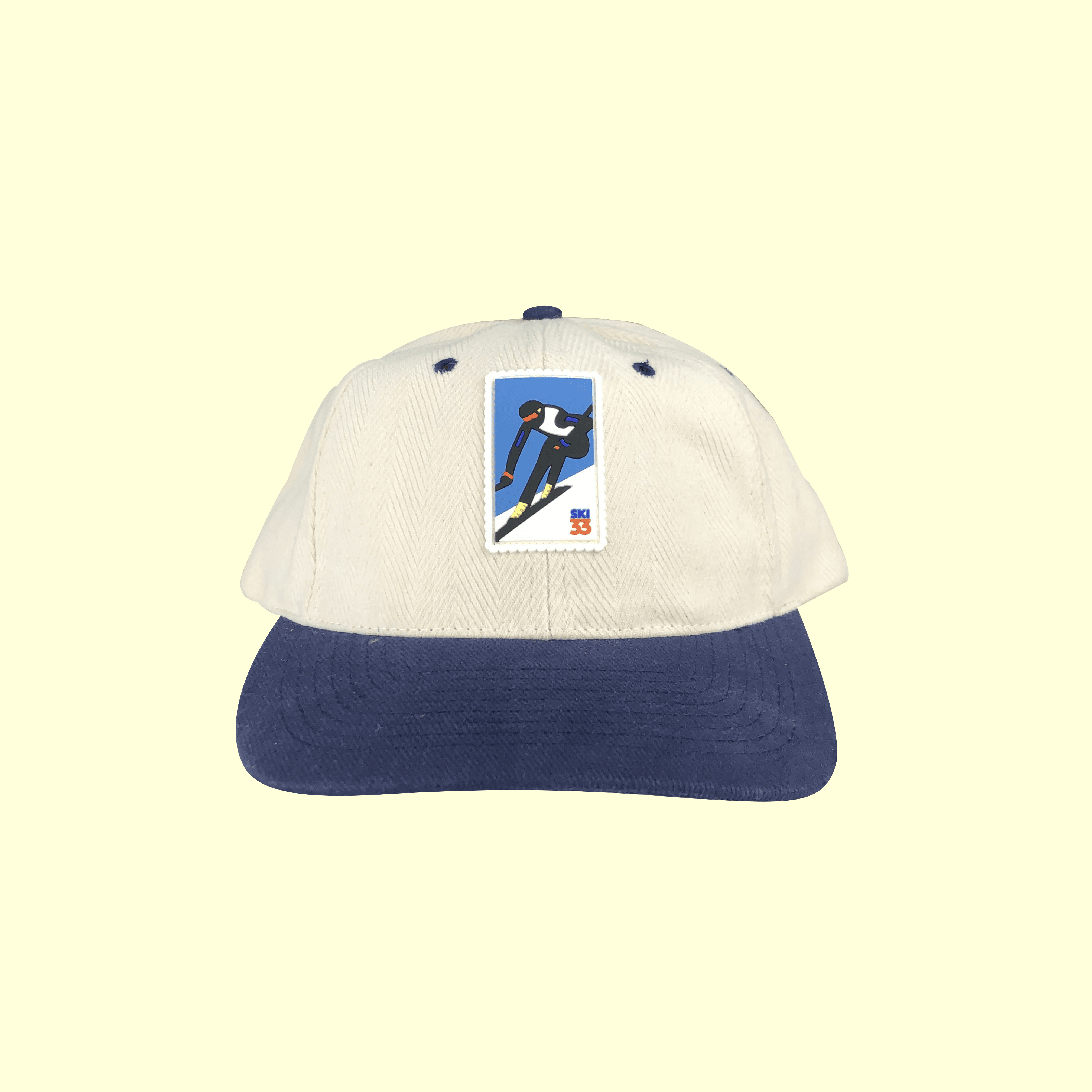 Lucky Lefty Strapback (White/Navy)