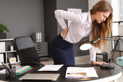 Office working woman in back pain