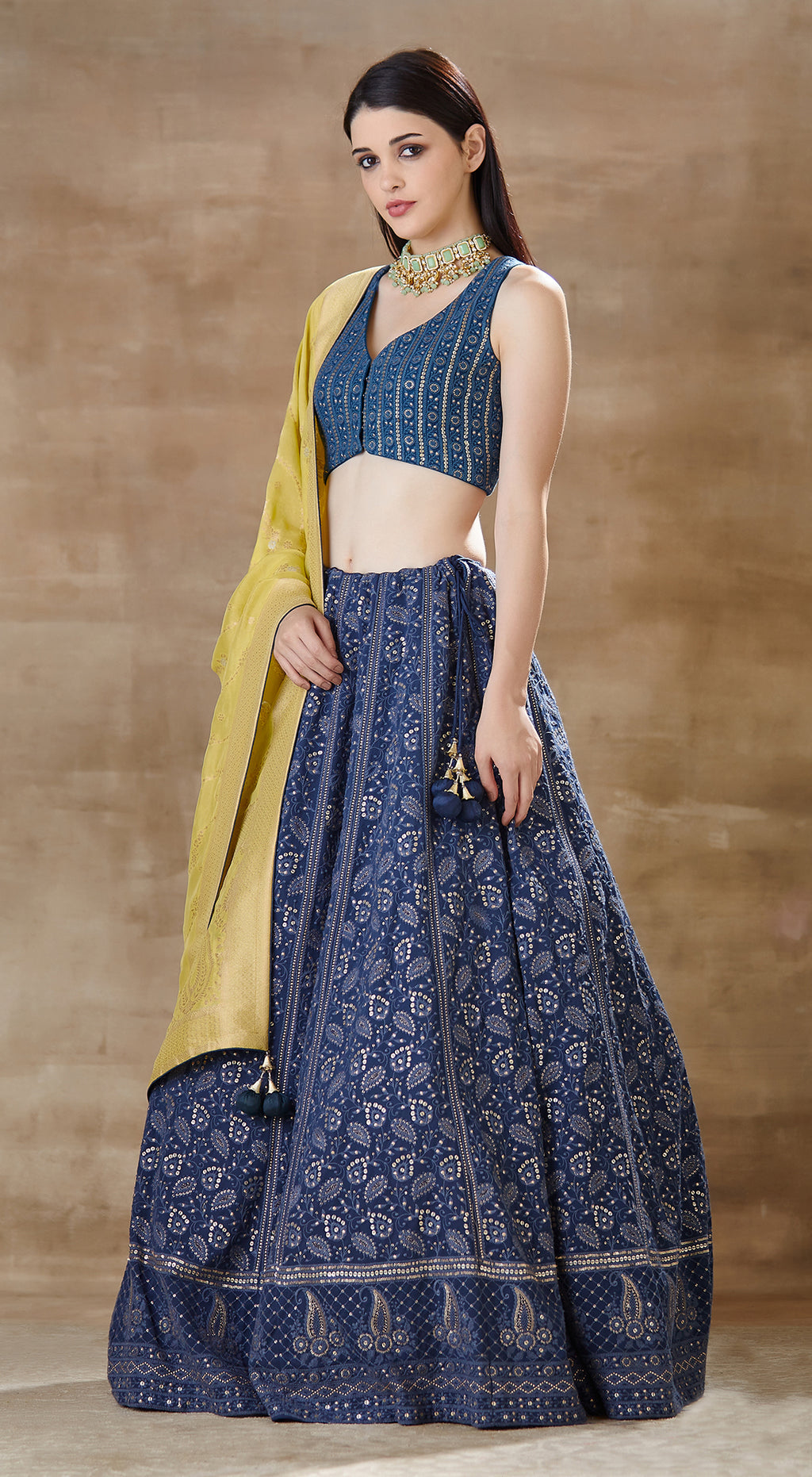 Blue lucknowi blouse with lucknowi lehenga paired with bright green banarsi dupatta.