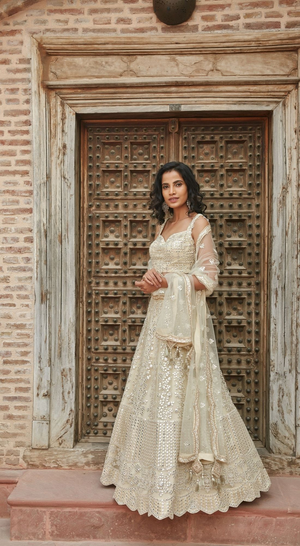 Thread Embroidered Net Off White Lehenga Set