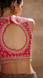 Rani pink embroidered blouse with charcoal lucknawi lehenga paired with rani pink organza dupatta.