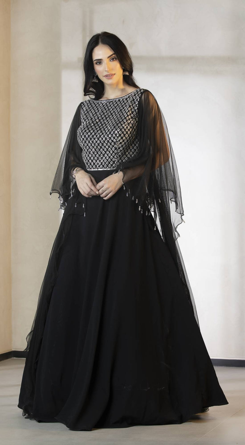 Black net gown with embellished bodice and long sleeves