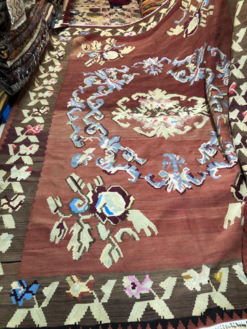 Antique kilim rug used for smoking and designer slipper and loafers