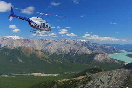 Fly over Lake Minnewanka on a Helicopter