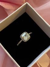 Load image into Gallery viewer, square cubic zirconia, platinum plated promise ring with halo, adjustable sizing, in a small pink box with a black velvety interior