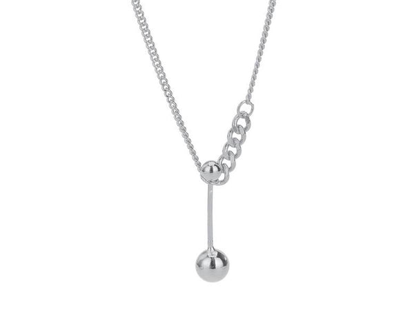 An image of a silver necklace with a ball pendant.