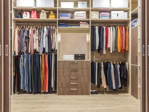 An image of a closet filled with organized clothes.