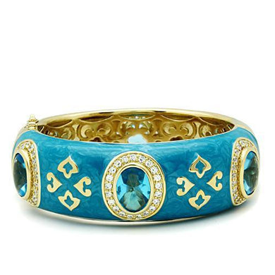 LO2250 - Gold Brass Bangle with Synthetic Synthetic Glass in Sea Blue