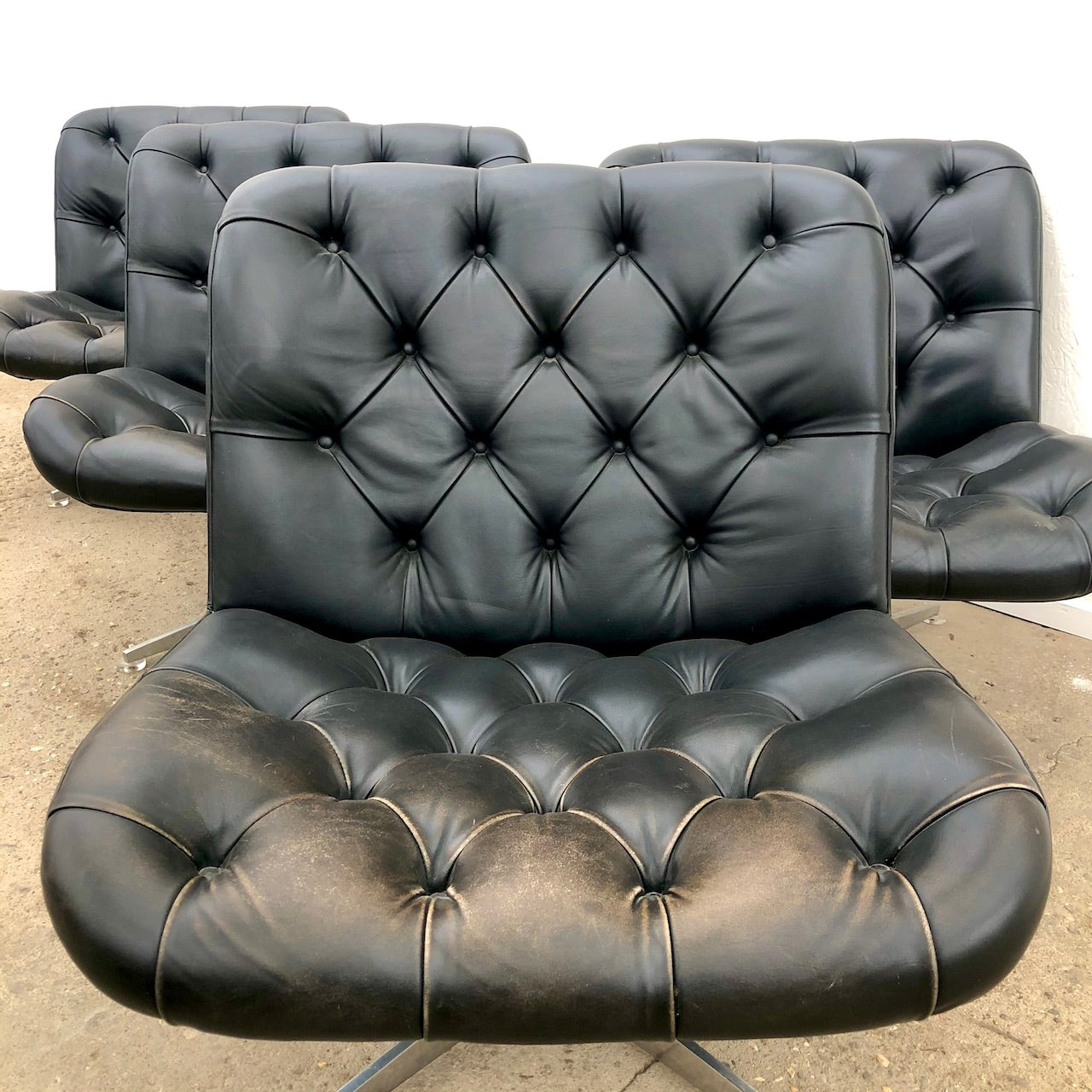 Set of 4 vintage black leather lounge chairs